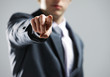 businessman  hand pointing out at you