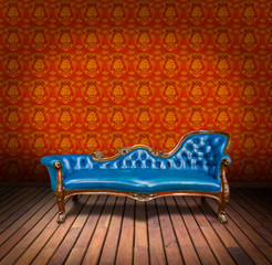 vintage blue luxury armchair and in yellow wallpaper room