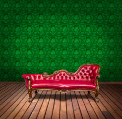 Sofa in green wallpaper room