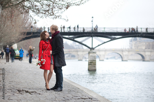 Romantic couple in love dating near Pont des Arts in Paris
