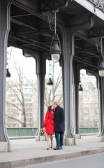 Romantic couple kissing on the Bir-Hakeim bridge