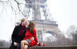 Romantic couple in love dating near the Eiffel Tower at spring o