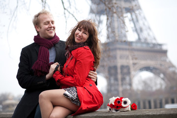 Happy couple in love dating near the Eiffel Tower at spring or a