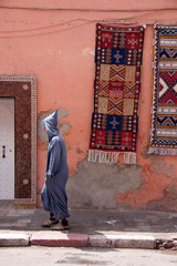 man walking in traditional dress in Morocco