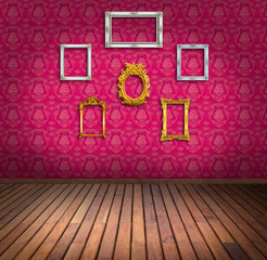 vintage frame in pink wallpaper room