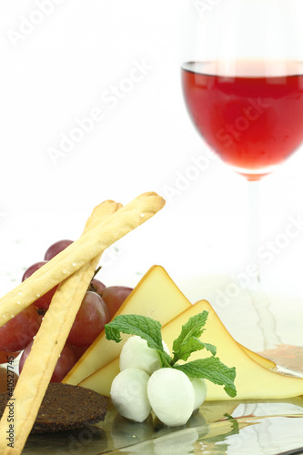 Appetizer with cheese, grissini and grapes