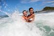 Cheerful couple enjoying the waves