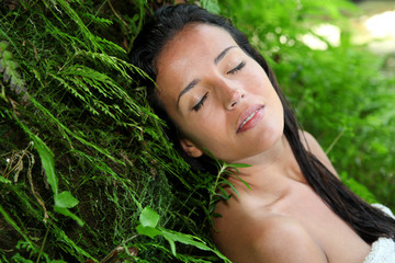 Attractive young woman in natural vegetation