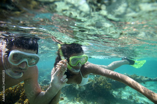 canvas print picture Couple snorkeling in Caribbean waters