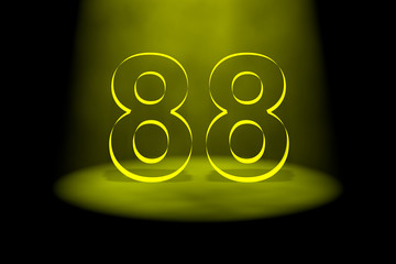 Number 88 illuminated with yellow light