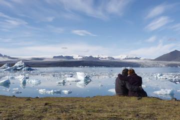 People enjoying the icebergs in Jokulsarlon, Iceland