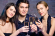 Young happy people with champagne at party