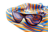 sunny glasses lie on the striped shawl