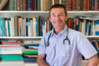 White Doctor In Front Of Books