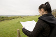 woman looking at map with countryside view