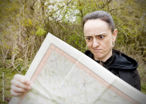 woman confused looking at map
