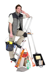 Tiler surrounded by his equipment