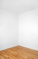 Empty corner of a room with wooden floor