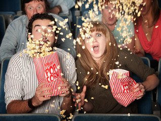 Scared Couple Spill Popcorn