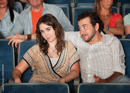 Man Flirting in Theater