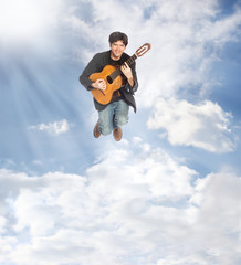 Guitarist Jumping in the Clouds