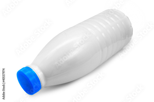 Leinwandbild Motiv plastic milk bottle lies on side isolated on white (clipping pat