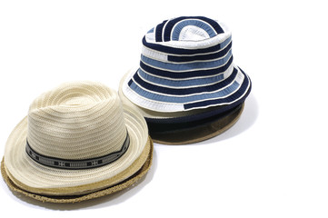 Straw hat with black band and traditional canvas hat