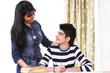 Student getting guidance from helpful teacher