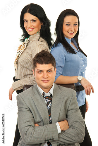 Manager surrounded by two secretaries