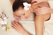 An attractive woman getting spa treatment, from above