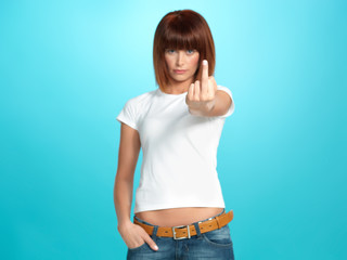 pretty young woman showing the middle finger