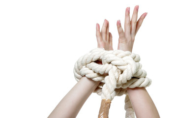 female hands tied up with rope over white