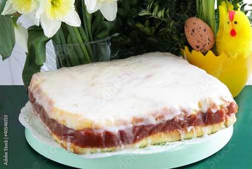 iced fruit-cake on Easter decorated table