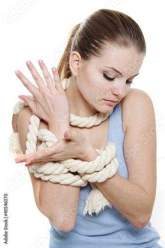 young woman tied up woth rope over white