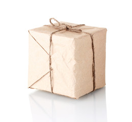 Small parcel wrapped in brown paper tied with twine isolated