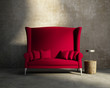 Red loveseat sofa vintage village interior, grunge wall