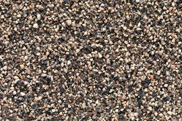 Crushed Black pepper (Piper nigrum) background.