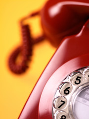 Red Phone on Yellow Background