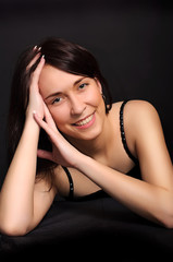 portrait of a young smiling brunette  woman
