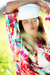 Beautiful gypsy girl with scarf standing in meadow