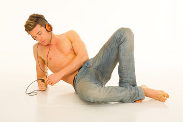 bare-chested man with headphones