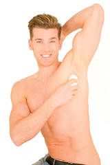 Young man applying deodorant