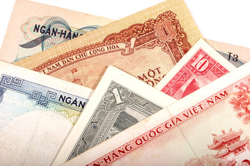 Different Asian banknotes on white