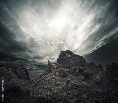 Dramatic sky over rocks.