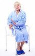 elderly woman, disabled, with shower seat as a medical supply