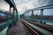 railway train bridge with cyan painted steel framework