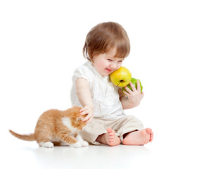 funny child with healthy food apples playing with Scottish kitte