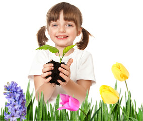 gardening concept - little girl helping with plant