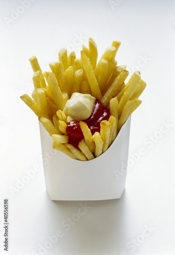 Chips with ketchup and mayo in white fast food box
