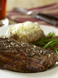 Grilled New York steak with green beans and baked potato